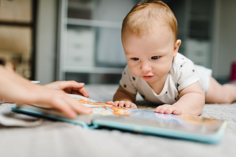 Baby boy looking at book